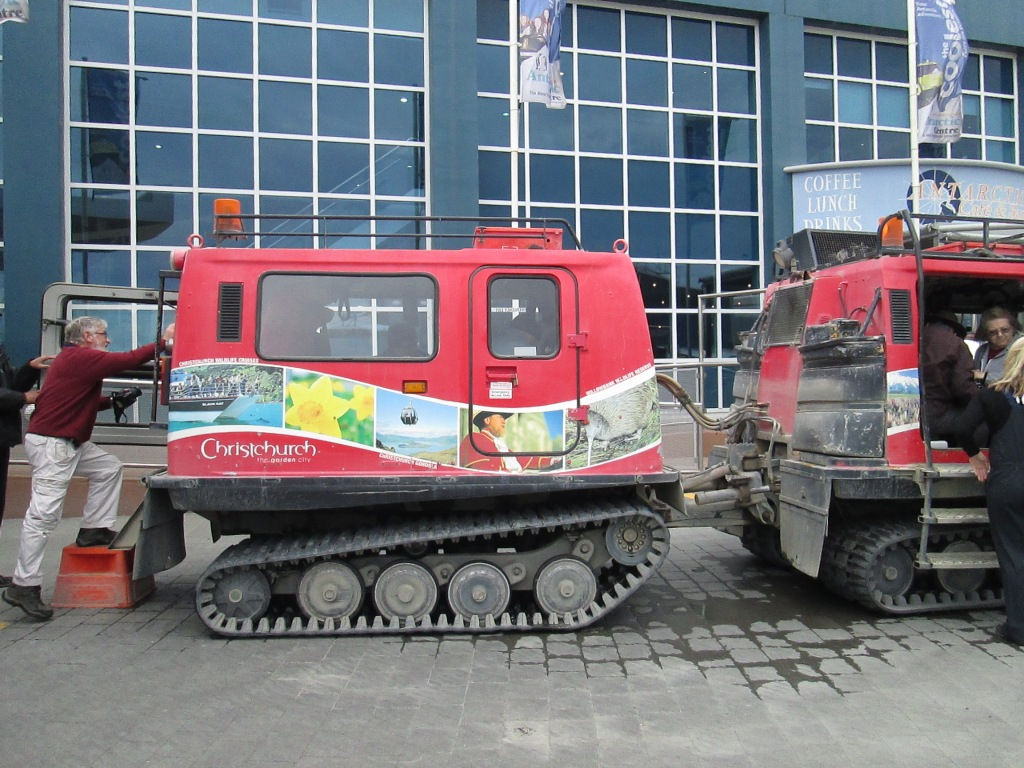 """First thing: a quick ride in a special vehicle designed to maneuver in antarctic conditions. It runs in subzero conditions, up and down steep embankments and on ice, can marginally float (we run through a """"puddle"""" that should just flood us, but doesn't) and even maneuver over cravasses of up to 2 meters wide.  [If you watch """"Live Below Zero"""" you might have seen vehicles like this.]"""